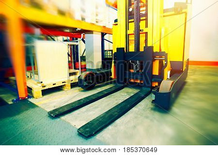 Shelves, Racks And Forklift Blured With Pallets In Distribution Warehouse Interior