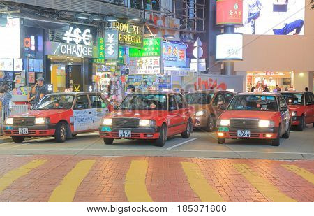 HONG KONG - NOVEMBER 9, 2016: Taxis wait for passengers in Causeway Bay shopping district.