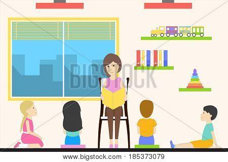 Kids playing in kindergarten. Woman reads a fairytail.
