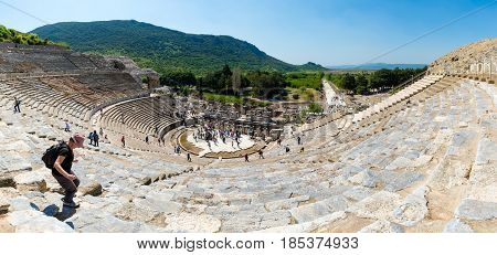 EPHESUS, TURKEY - APRIL 13 : A group of tourists in Ephesus Turkey on April 13, 2015. Ephesus contains the ancient largest collection of Roman ruins in the eastern Mediterranean.