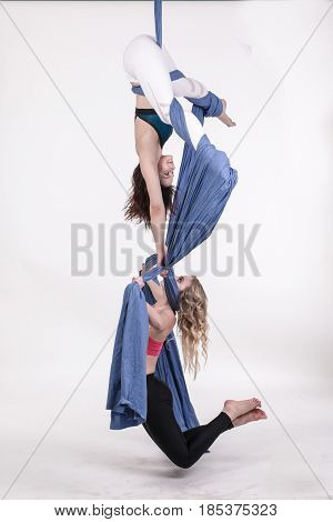 Nice girls and sports exercises with aerial silk