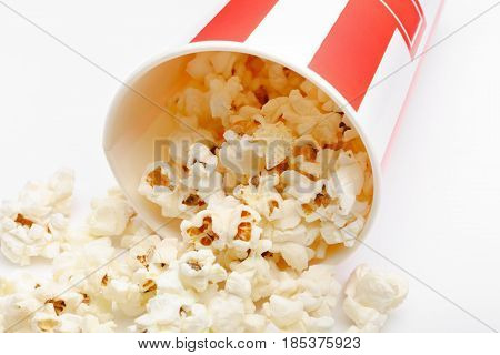Popcorn In Red And White Cardboard Box. Popcorn Border Isolated On White. Film. Fast Food. Corn