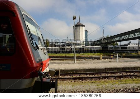 Muehldorf,Germany-May 7,2017: A passenger train and freight train locomotives stand in the yards of a station