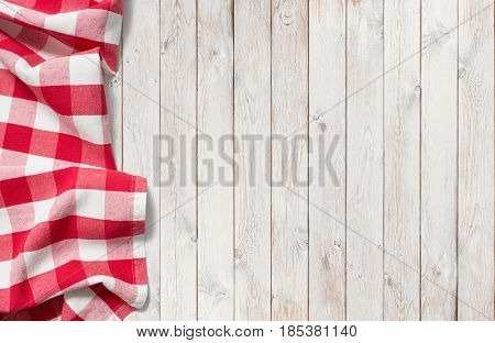 red picnic cloth on white wood table