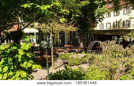 Regensburg,Germany-May 7,2017: The tables in a beergarden are still empty late in a saturday morning