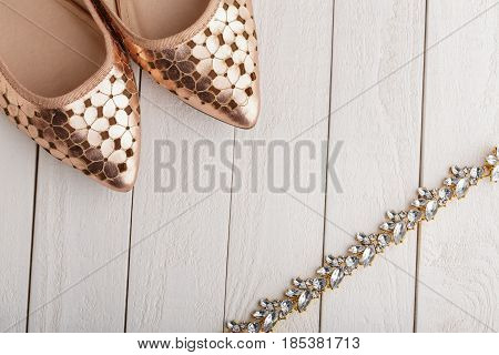 Women's Accessories.women's Fashion, Gold Shoes And Diamonds Necklace On Wooden White Background. St