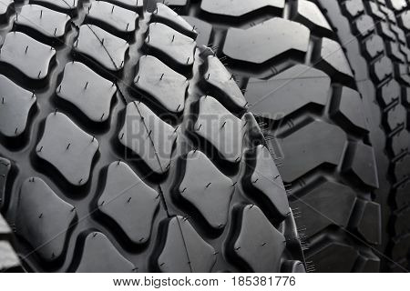 Big truck wheel a black tires closeup