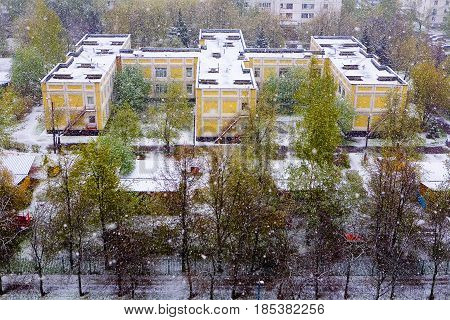 Moscow Russia May 8 2017: A natural phenomenon. Unexpected spring snowfall.