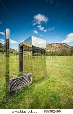 The mirrored Cabin sits on a narrow strip of land between Loch Voil and Loch Doine reflecting and framing the water mountains and glens that surround it