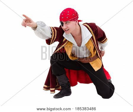 man wearing a pirate costume posing with pointing gesture, isolated on white in full length.