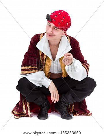 man wearing a pirate costume posing, isolated on white in full length.