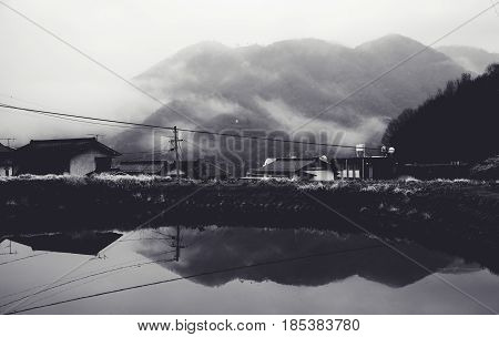 View overlooking the mountain in morning haze, Takahashi town, Okayama prefecture, Japan