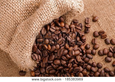 Coffee Beans On Burlap Background. Roasted Coffee Beans Isolated In White Background. Roasted Coffee