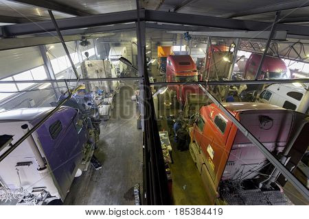 Nizhny Novgorod, RUSSIA - MARCH 19, 2017: View inside the hangar, where repairing heavy machinery and automobiles. Russia.