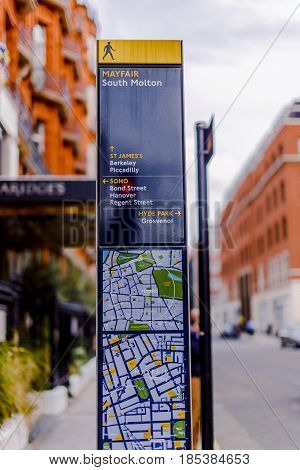 Road Sign In London Listing Famous Landmarks Like Mayfair And Soho With Beautiful Architecture Bokeh