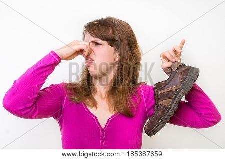 Woman With Stinky Shoe Of Her Husband