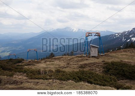 ski lift in the mountains Spring time. no people no turist no snow