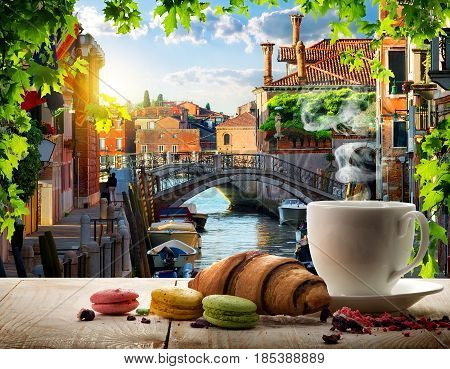Romantic breakfast with coffee and sweets in Venice, Italy