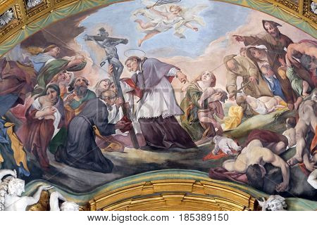 ROME, ITALY - SEPTEMBER 03: St. Charles Borromeo Combating the Plague by Pietro da Cortona in Basilica dei Santi Ambrogio e Carlo al Corso, Rome, Italy on September 03, 2016.