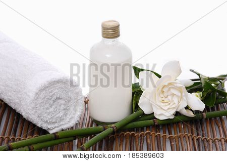 gardenia with rolled towel,grove with oil on mat
