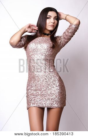 Portrait Of Beautiful Brunette Woman In Pink Dress. Fashion Photo Shot.