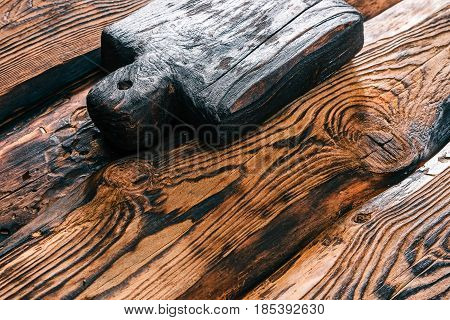 Background of textured burned pine wood with rustic handmade cutting board