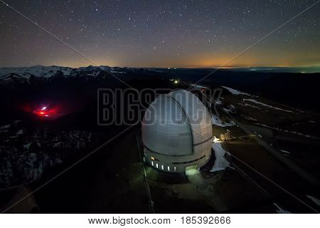 Night view from above to the large dome of the telescope of the special astrophysical observatory in the Arkhyz mountains.