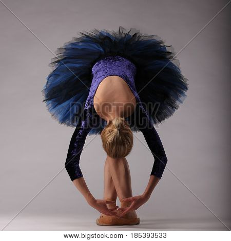 Beautiful Ballerina In Blue Posing And Dancing In Studio. Classical Ballet Art.