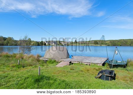 lake in French Limousin with fishing tent and place