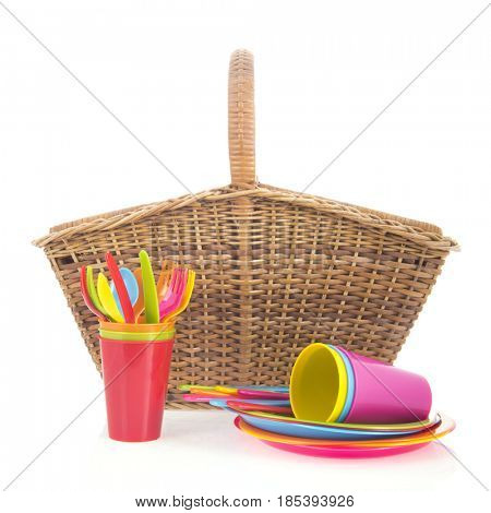 Picnic wicker basket crockery and cutlery in all colors isolated over white background