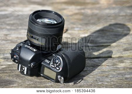 VILNIUS - MAY 8: Nikon F-100 film camera with Nikkor 85mm lens on May 8 2017 in Vilnius Lithuania. Nikon Corporation specializing in optics and imaging products.