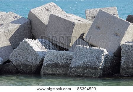 Breakwater made of concrete cubes along Salerno coastline