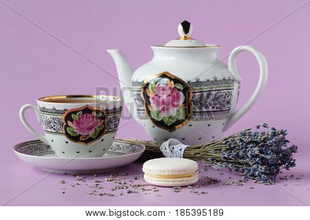 Cup Of Herbal Tea With A Porcelainkettle And A Lavender Bouquet