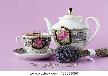 Cup Of Herbal Tea Decorated With Fresh And Dry Lavender Herbs. Porcelain Cup Of Tea Drink Garnished