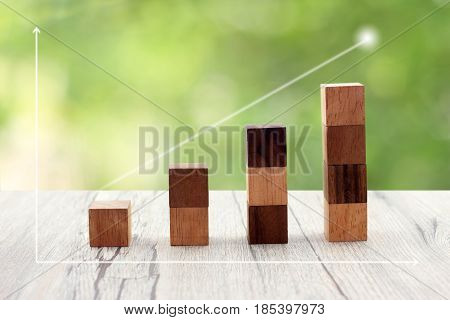 Toy Wood Blocks As Increasing Graph Chart On .over Blur And Sunlight Background. Business Concept Gr