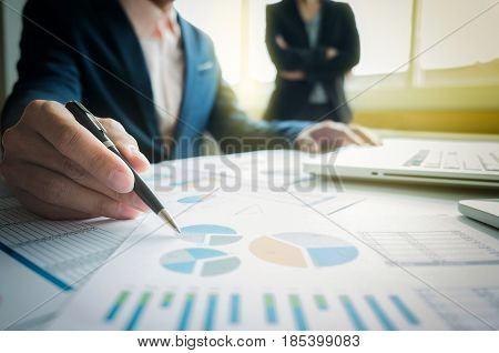 Business adviser analyzing financial figures denoting the progress in work of company business concept.