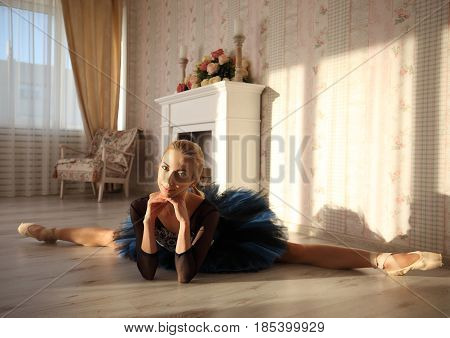 Beautiful Young Woman Ballerina Stretching In Home Interior, Split On Floor