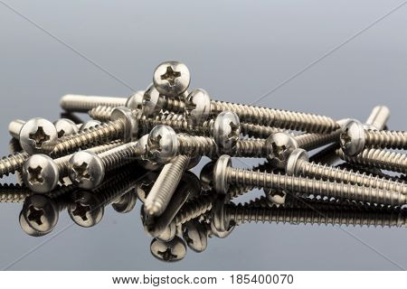 different screws on a reflecting surface