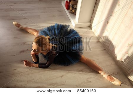 Beautiful Young Woman Ballerina Stretching Warming Up In Home Interior, Split On Floor