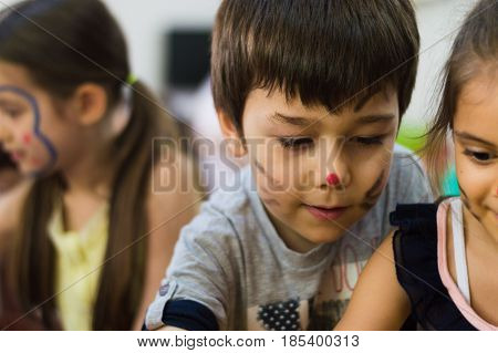 Eskisehir, Turkey - May 05, 2017: Little Boy With Colored Face Enjoying Being With His Friends In Ki