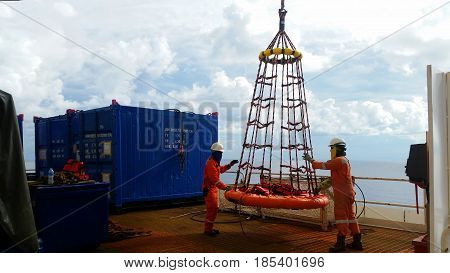 personal basket  is lifted by the crane to the offshore platform, Transfer crews by personal basket from the platform to crews boat