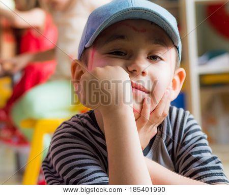 Eskisehir, Turkey - May 05, 2017: Preschool Boy With Blue Hat Posing In A Classroom