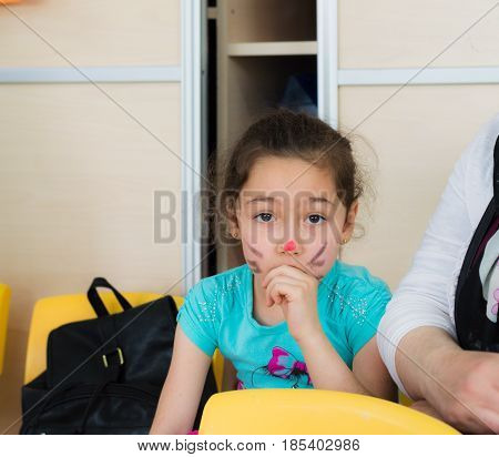 Eskisehir, Turkey - May 05, 2017: Preschool Little Girl With Colored Face Sitting In Classroom With