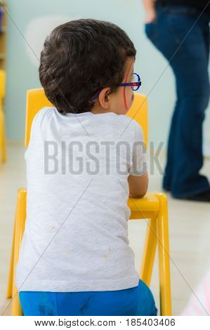 Eskisehir, Turkey - May 05, 2017: Kindergarten Boy With Glasses And Colored Face In A Classroom