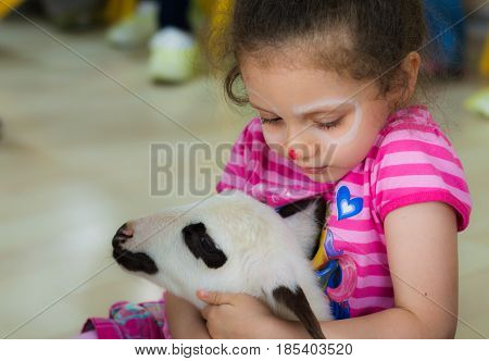 Eskisehir, Turkey - May 05, 2017:  Sweet Little Girl Caressing A Lamb  At The Animal Days Event In T