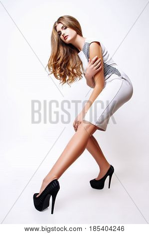 Fashion Portrait Of Beautiful Young Woman With Long Hair. Girl In A White Dress On A White Backgroun