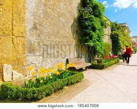 Salzburg, Austria - May 01, 2017: The people going at the beautiful Mirabell gardens in Salzburg. It is a popular destination visited by tourists at Salzburg, Austria on May 01, 2017