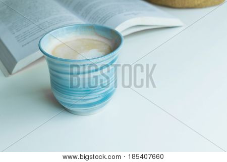 Blue Coffee Cup On The Desk With Books. Concept Coffee Lover Background.
