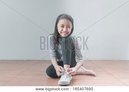 Beautiful Little Girl Is Smiling And Tied Up With A Shoelace.