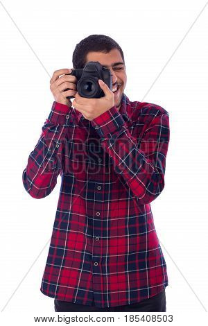 Happy smiley friendly young photographer taking a photo guy wearing red caro shirt and jeans isolated on white background